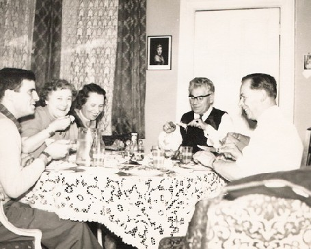 Black and white photograph of a dinner party