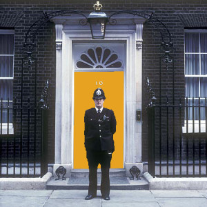 The orange front door of number ten ( 10 ) Downing Street - the British (Britain, UK, United Kingdom,Great Britain) Prime Minister's residence.