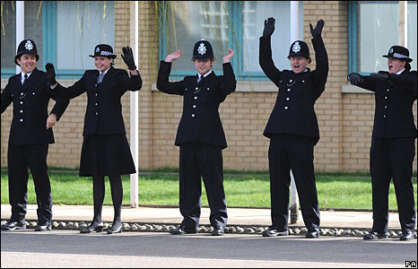Uniformed British Police doing a Mexican Wave