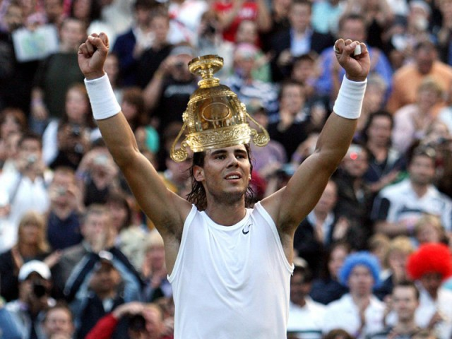 Rafael (Rafa) Nadal with the Wimbledon Men's trophy on his head