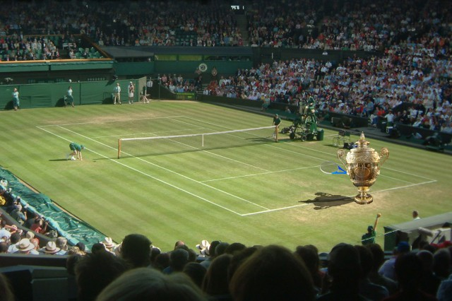 (Rafa) Nadal hiding behind the Men's Wimbledon trophy on centre court