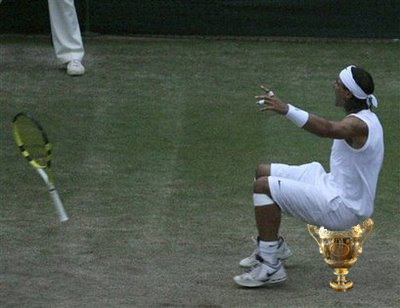 Rafael (Rafa) Nadal using the Men's Wimbledon trophy as a seat