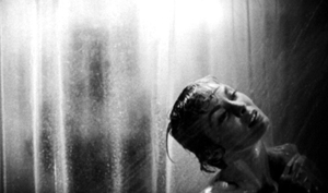 Janet Leigh in the shower in the Hitchcock film Psycho.