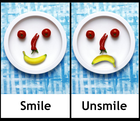 A smiling banana on a plate and an unsmiling banana on a plate