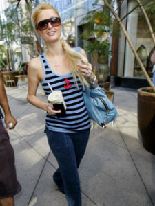 Paris Hilton Sporting a nautical look horizontally striped vest with an anchor motif