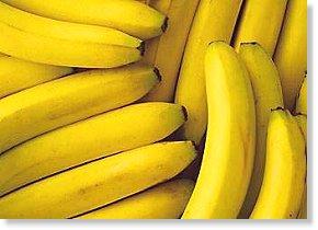 A photo of many yellow Cavendish bananas (banana)