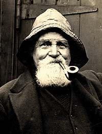 A bearded sailor with a pipe and a Sowester