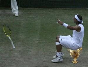 Rafael (Rafa) Nadal using the Men's Wimbledon trophy as a seat