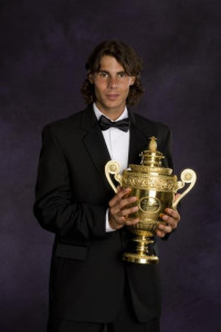 Rafael (Rafa) Nadal in evening dress (a dinner jacket, a tuxedo) with the Men's Wimbledon trophy.